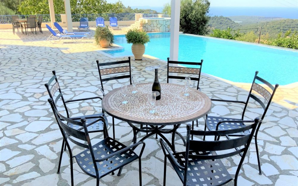 round-table-and-view-scaled-roula-rouva-corfu-real-estate